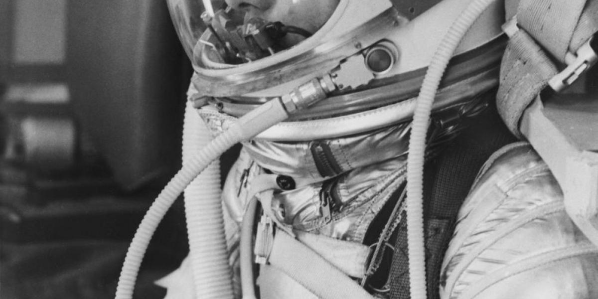 A black and white image of Alan Shepard in a pressure suit.