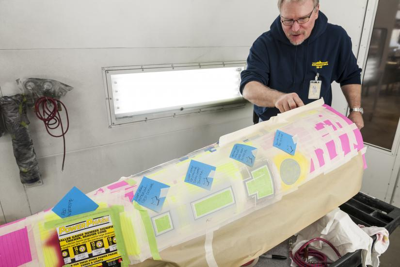Post-it notes and masking tape create an outline on the model's secondary hull.