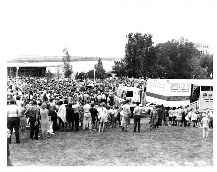 Trailer surrounded by crowd.