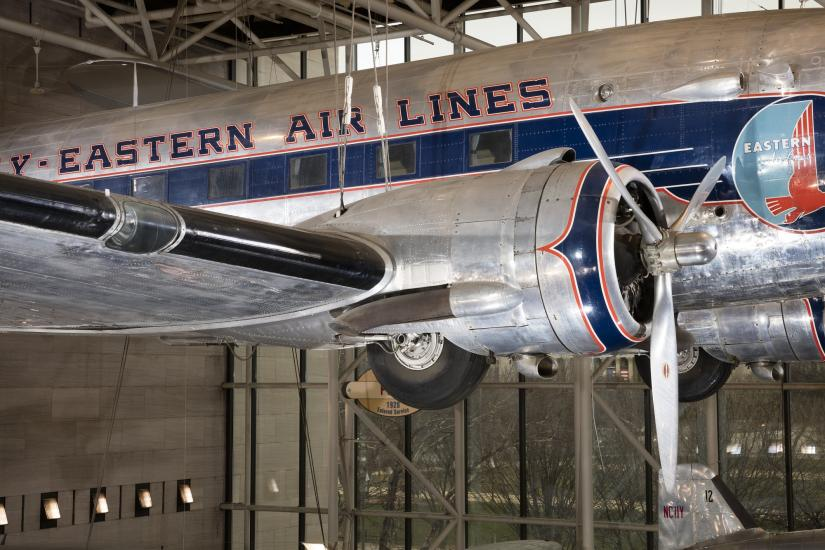 Side propeller and body of Douglas DC-3 aircraft hanging in museum