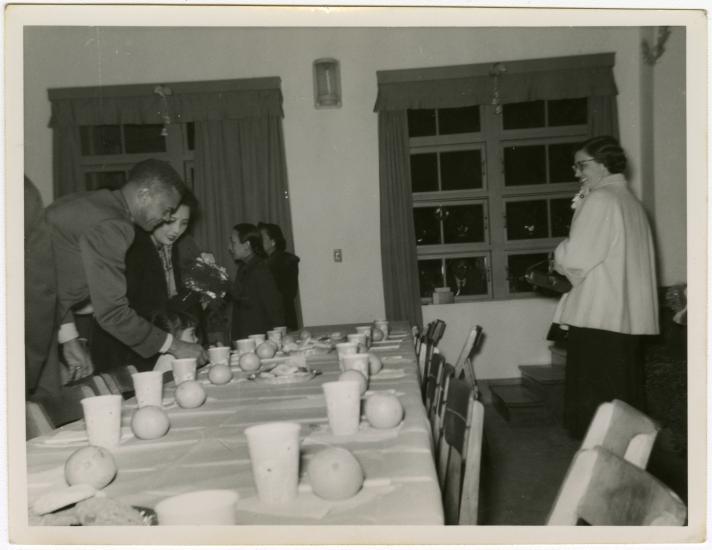 Ben Davis and Madame Chiang Kai-Shek at a party table