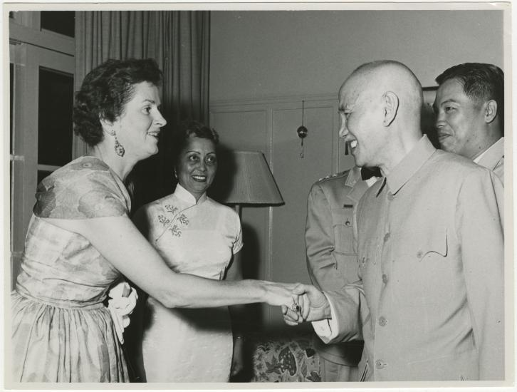 Agatha Davis watches Chiang Kai-Shek shake a woman's hand
