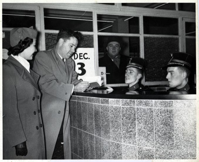 Lanphier presents his passport in Belgium