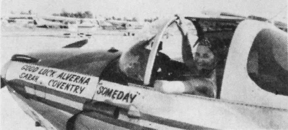 "Black and white image of a woman in the cockpit of an airplane. Painted text of the side of the airplane reads: ""[first line on left] Good luck Alverna [Second line on left] Sarah Coventry [centered line on right] Someday"""