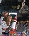 Girl Looks through Telescope at Udvar-Hazy Center