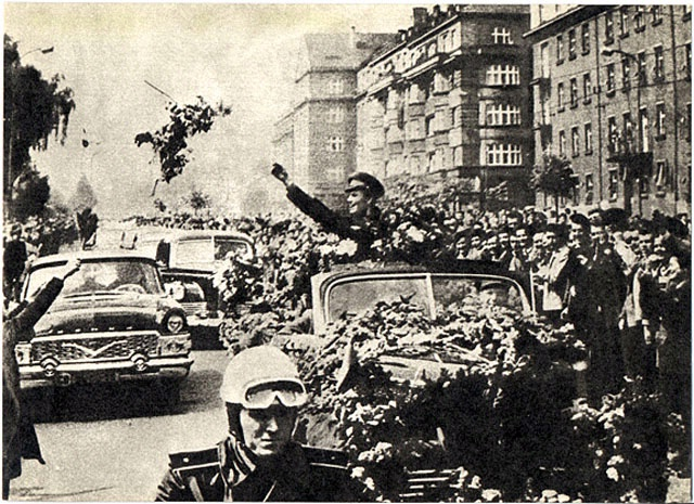 Gagarin waves to crowds en route to Red Square.