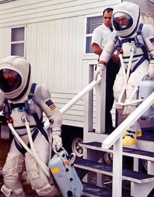 Gemini 7 prime crew leaves suiting trailer during prelaunch countdown
