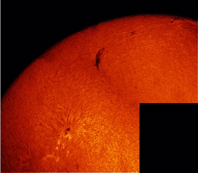 This mosaic of 2 images highlights a large Sunspot group, as well as a dark filament in the Sun's chromosphere.