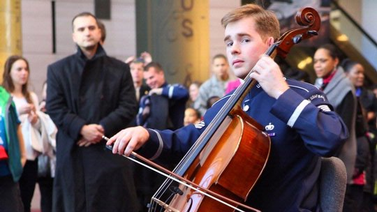 Cellist Plays During Flash Mob at the Museum