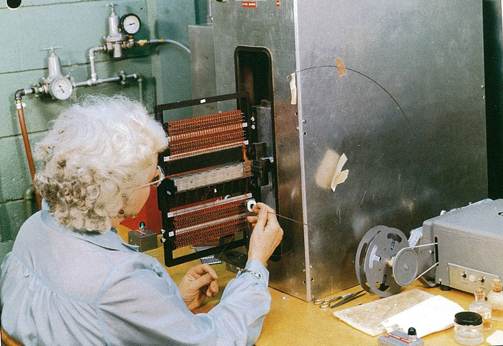 A woman weaving the core ropes at the Raytheon plant