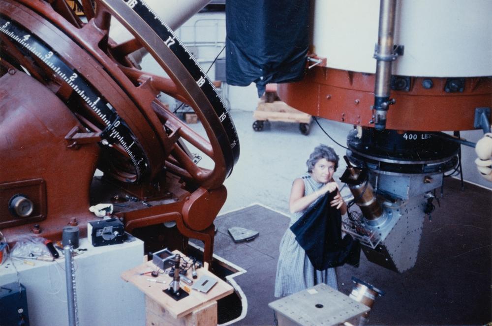 Vera Rubin in front of telescope.