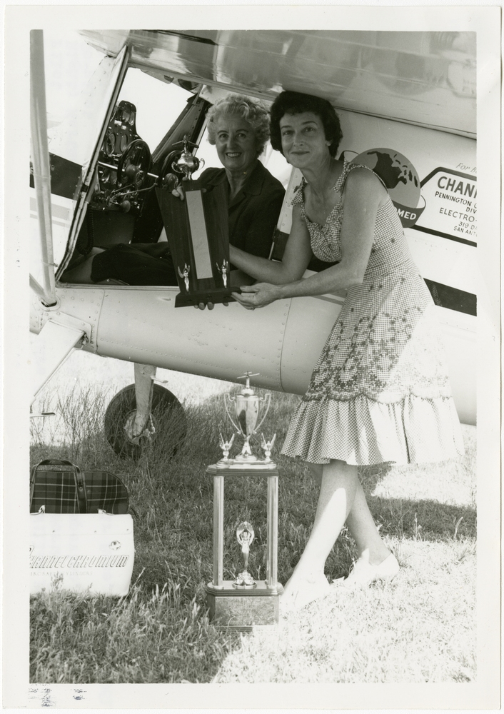 Winning Female Pilots Pose with Trophies