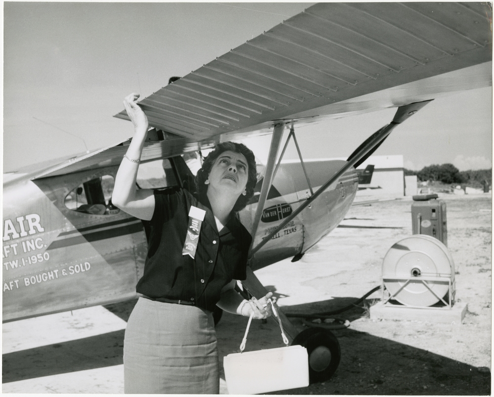 Pilot Margaret Callaway checks the right aileron of her Cessna 140