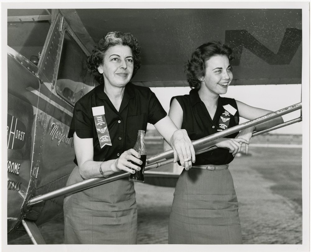 Margaret Callaway and her co-pilot Paula Jane Schultz stand next to their Cessna 140