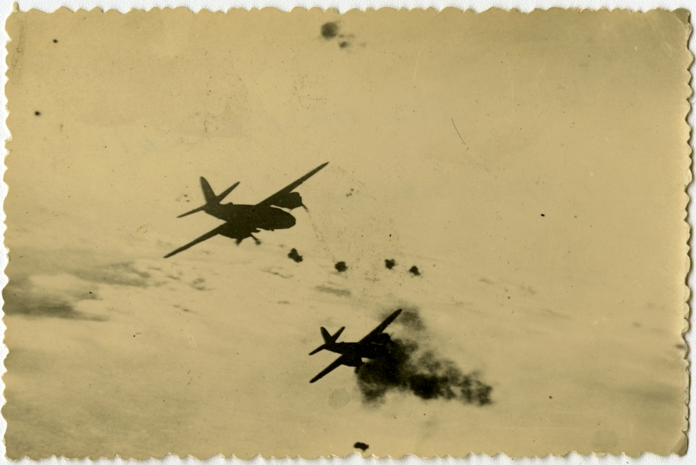 Two Marauders in flight with black flak bursts