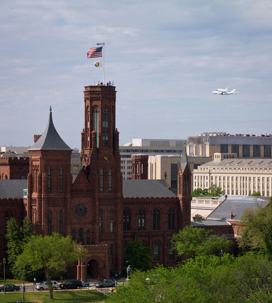 Space Shuttle Discovery Flies near the Smithsonian Castle