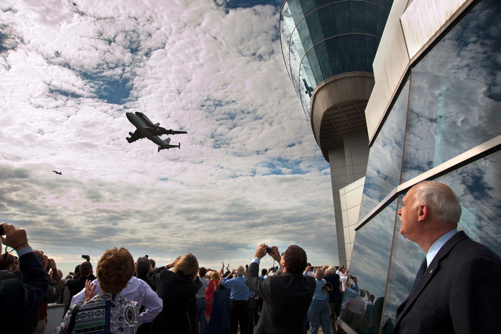 Space Shuttle Discovery passes by the Donald Engen Observation Tower
