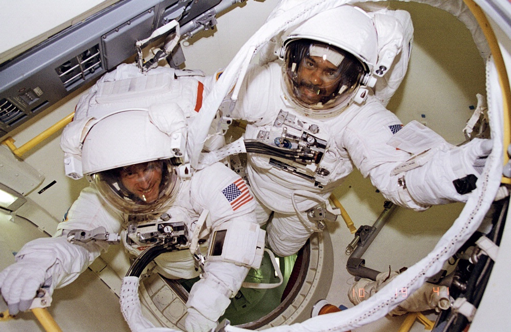 Bernard Harris and Michael Foale prepare to leave airlock
