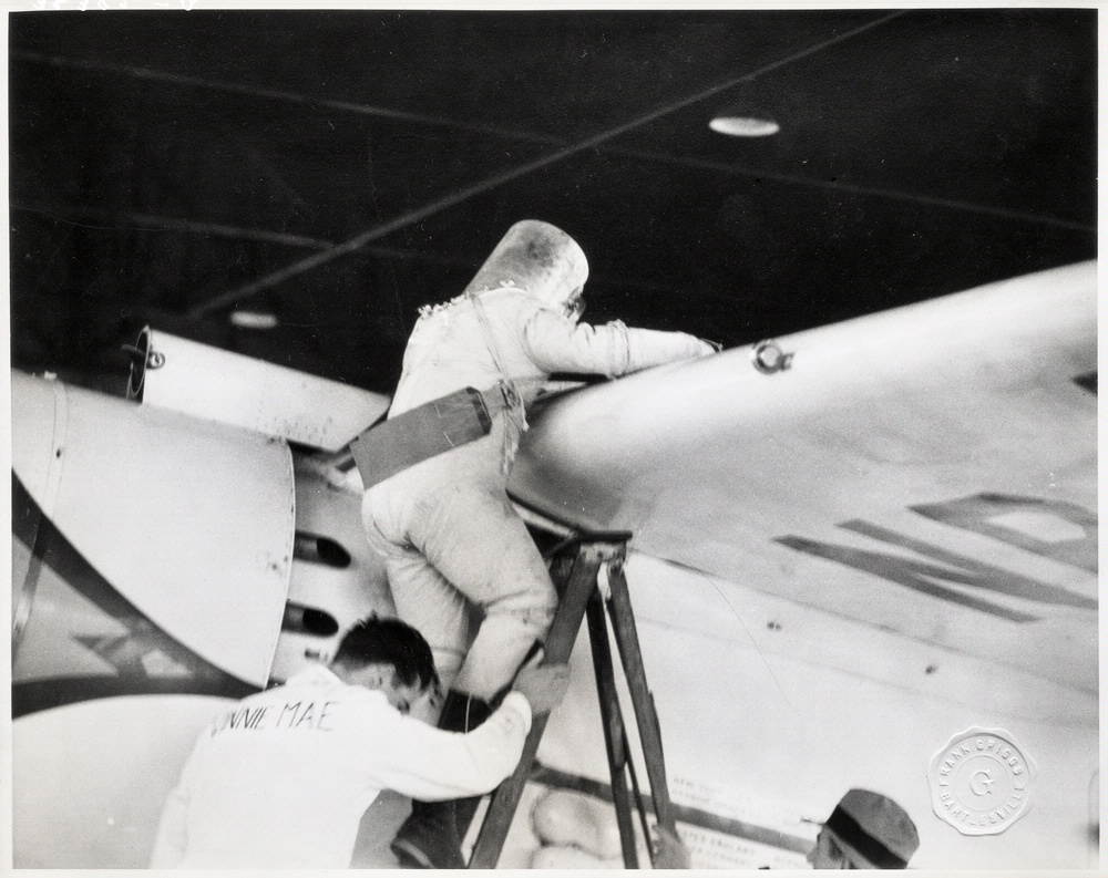 Wiley Post Climbing into the Winnie Mae with his Pressure Suit