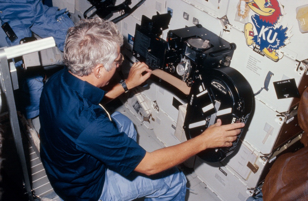 Hartsfield loading film into the IMAX camera on the STS-41D mission