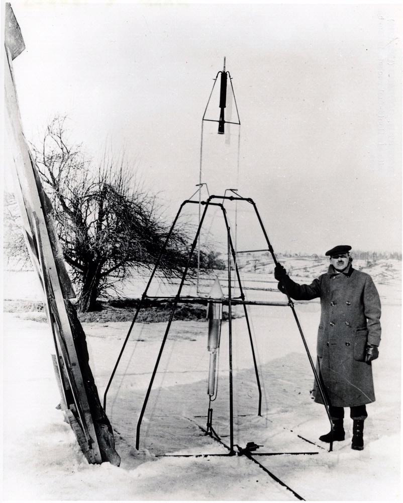 Robert Goddard standing in front of his March 1926 rocket.