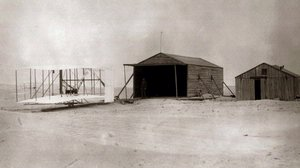Wilbur Wright with 1903 Flyer