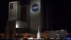 Orion Spacecraft Rolls Past the Vehicle Assembly Building