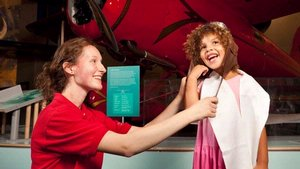 Museum Explainer with Young Visitor